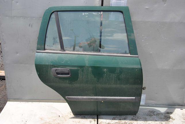 Opel Astra G kombi drzwi prawy tył