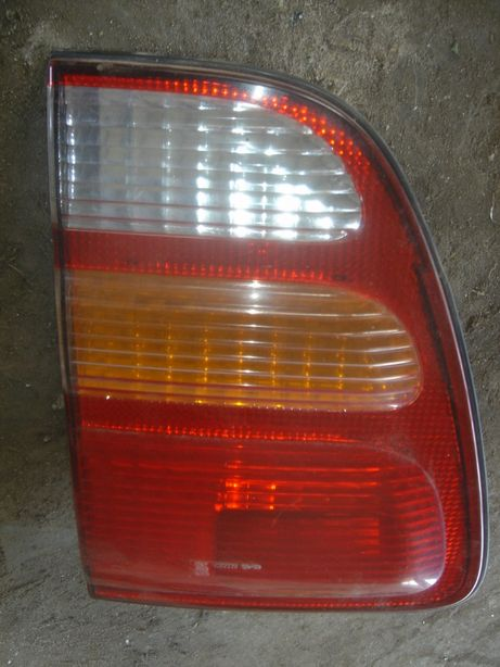 Toyota Land Cruiser 100 lampa tył Lewa