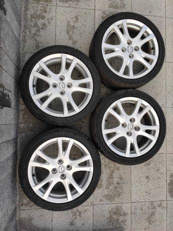 Alufelgi 16 z oponami Mazda - komplet