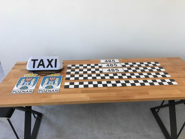 Nowy komplet taxi (lampa, okleiny - magnez)