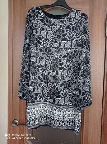 Жіноче плаття з шифоновим рукавом