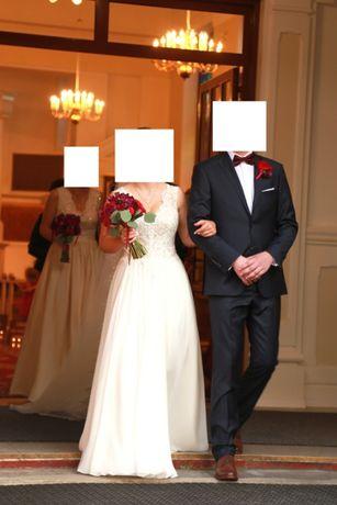 Piękna suknia ślubna z welonami Roz.38