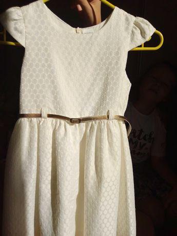 Sukienka ecri , bardzo zgrabna z podszewką rozm.110