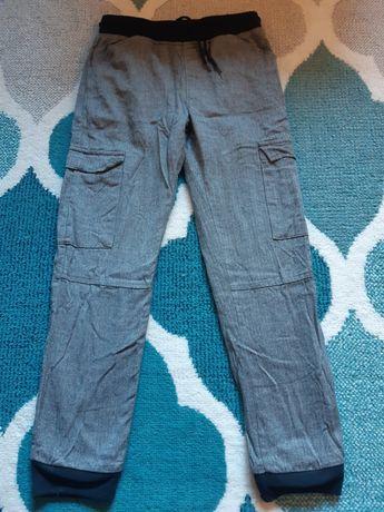 Spodnie z kieszeniami rozm 140