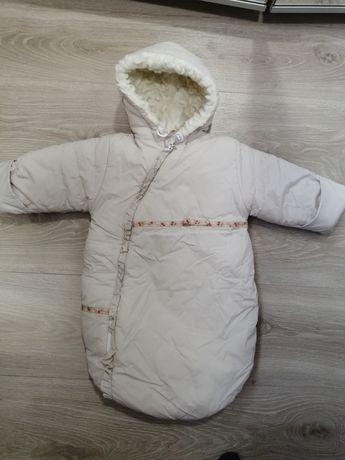 Зимний, тёплый комбинезон для новорождённого.