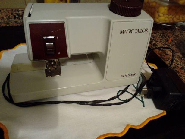 Maquina de costura a funcionar