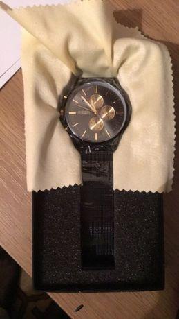 NOWY zegarek Liandu POLECAM bardzo elegancki złoty czarny metalowy