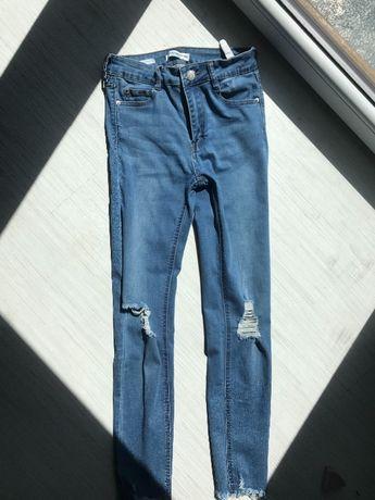 Spodnie z wysokim stanem jeansy z dziurami na kolanach postrzępione