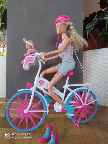 Lalka na rowerze z dzieckiem