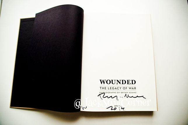 Bryan Adams autograf - Wounded: the legacy of war - album/książka