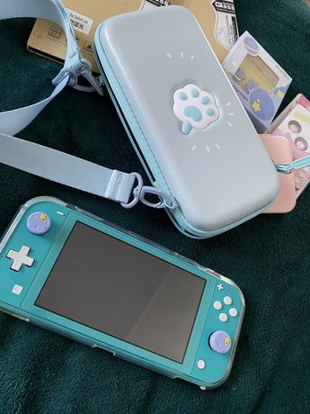 Nintendo Switch Lite + Animal Crossing i inne gry + online 3 msc