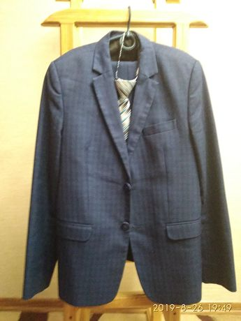 Продам школьный костюм синего цвета в клетку