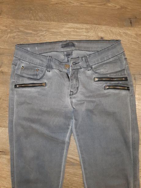 Spodnie jeansy damskie S