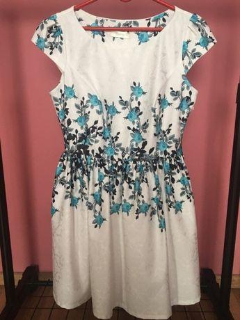 sukienka rozkloszowana w kwiaty 40