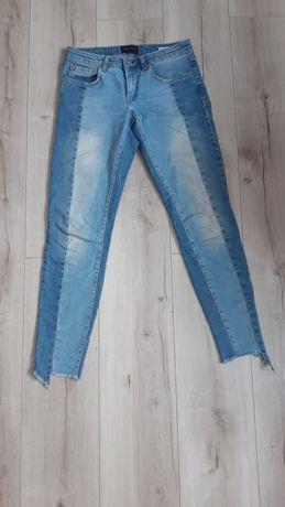 Dwukolorowe jeansy