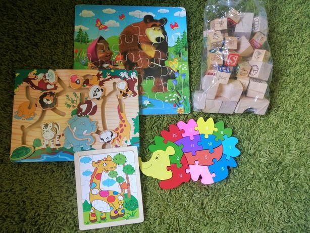 Дерев'яні пазли, кубики, іграшки.
