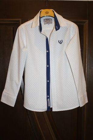 Продам білу сорочку на хлопчика в ідеальному стані 134р