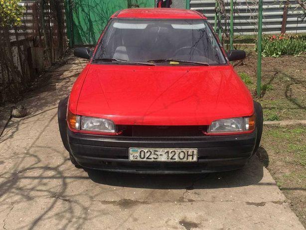 MAZDA 323 coupe compact