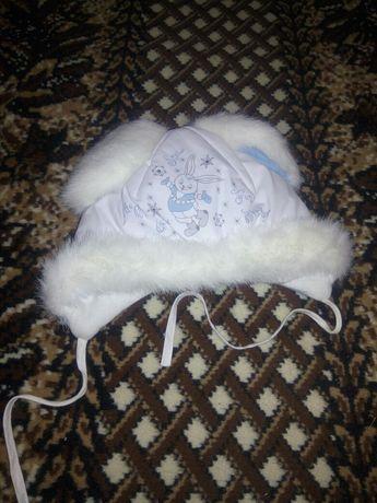 Нова шапка зимова