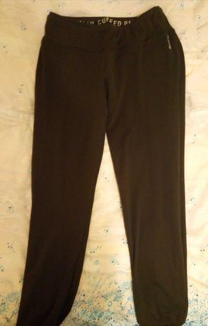 Sportowe spodnie z niskim stanem Reebok