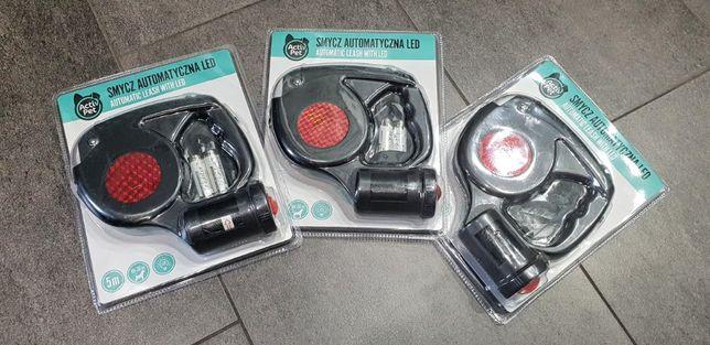 Smycz automatyczna z latarką LED i pojemnikiem na worki