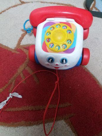 Детский телефон с глазками
