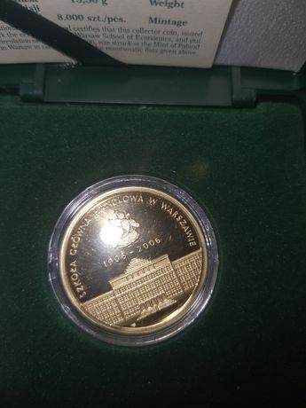Sprzedam monetę złotą szkoła główna handlowa w Warszawie nominał 200