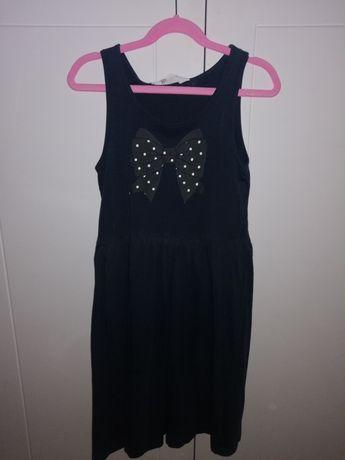 Sukienka H&M Rom. 134 /140 Stan bdb. Granatowa, wzór kokardki.