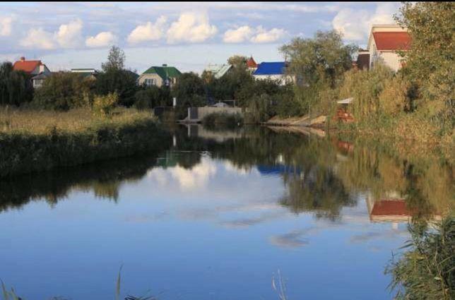 20 соток на берегу реки под мини турбазу, кемпинг, ресторан.