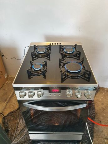 Kuchenka gazowa z piekarnikiem elektrycznym grillem Srebrna100%sprawna