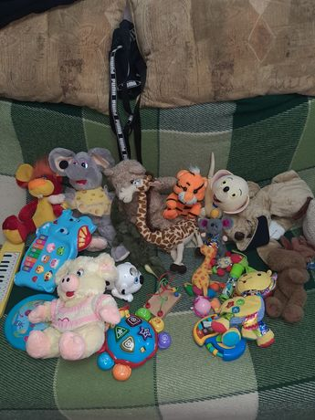 Детские игрушки музыкальные и мягкие