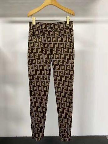 Nowe piekne spodnie logo Fendi S M elastyczne wysoki stan rurki 36/38