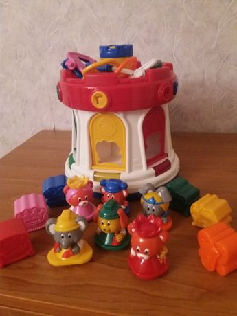 "Музыкальная игрушка-сортер Chicco ""Замок"""