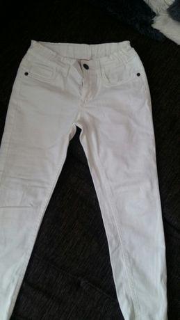 Spodnie białe ze zamkami