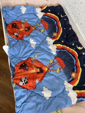 Теплое одеяло в кроватку