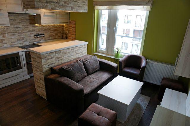 kanapa,łóżko,sofa 2 osobowa z funkcją spania pojemnik oraz dwie pufy