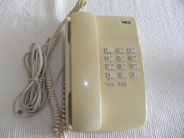 Telefone NEC em bom estado de conservação e funcionamento.