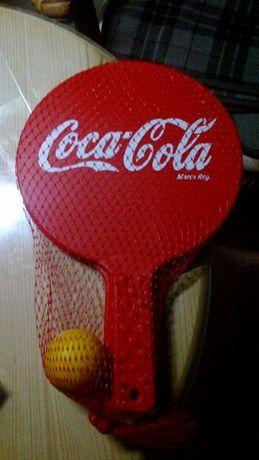 2 raquetes coca cola com bola borraxa