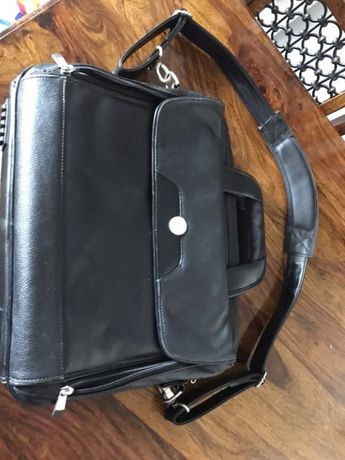 Dell, torba na komputer i dokumenty.