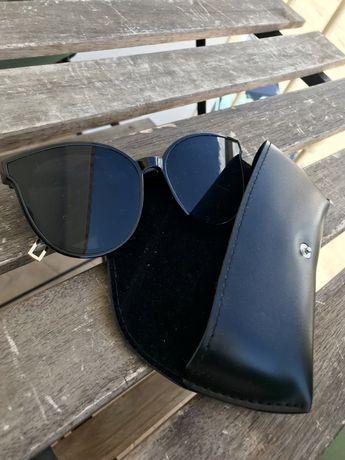 Oculos de sol pretos
