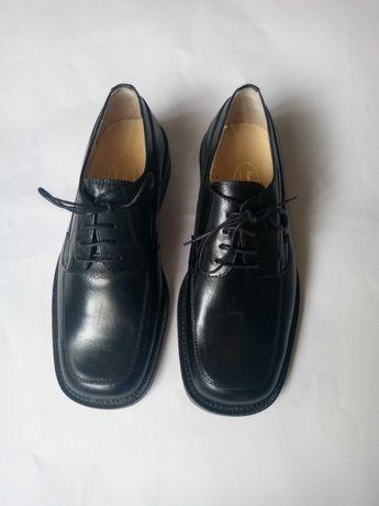 Sapatos sola de couro