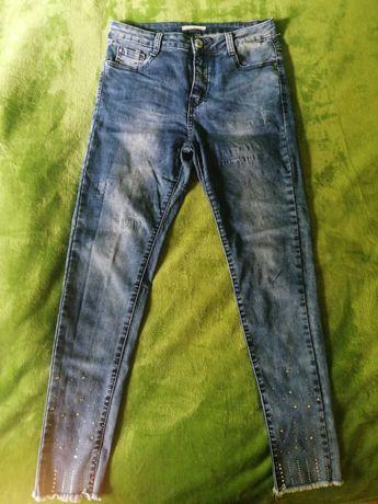 Damskie spodnie jeansowe