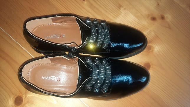 Нове жіноче  взуття