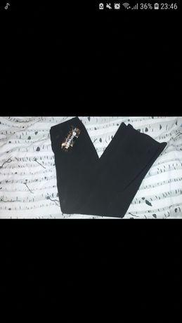 Spodnie garniturowe typu dzwony