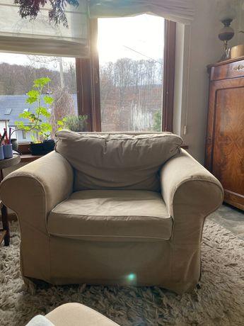 Fotel ikea ektrop w bezowym pokrowcu z lamowką - klasyka.