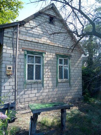 Земельный участок с домом и гаражом