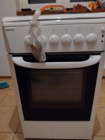 Kuchenka gazowa z piekarnikiem elektrycznym Beko