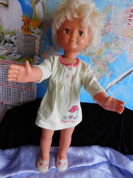 кукла говорящая.