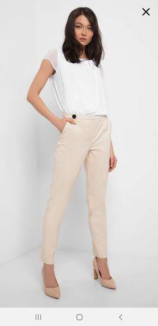 Spodnie w kant Orsay beżowe nowe