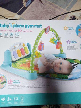 Дитячий коврик з музикою.